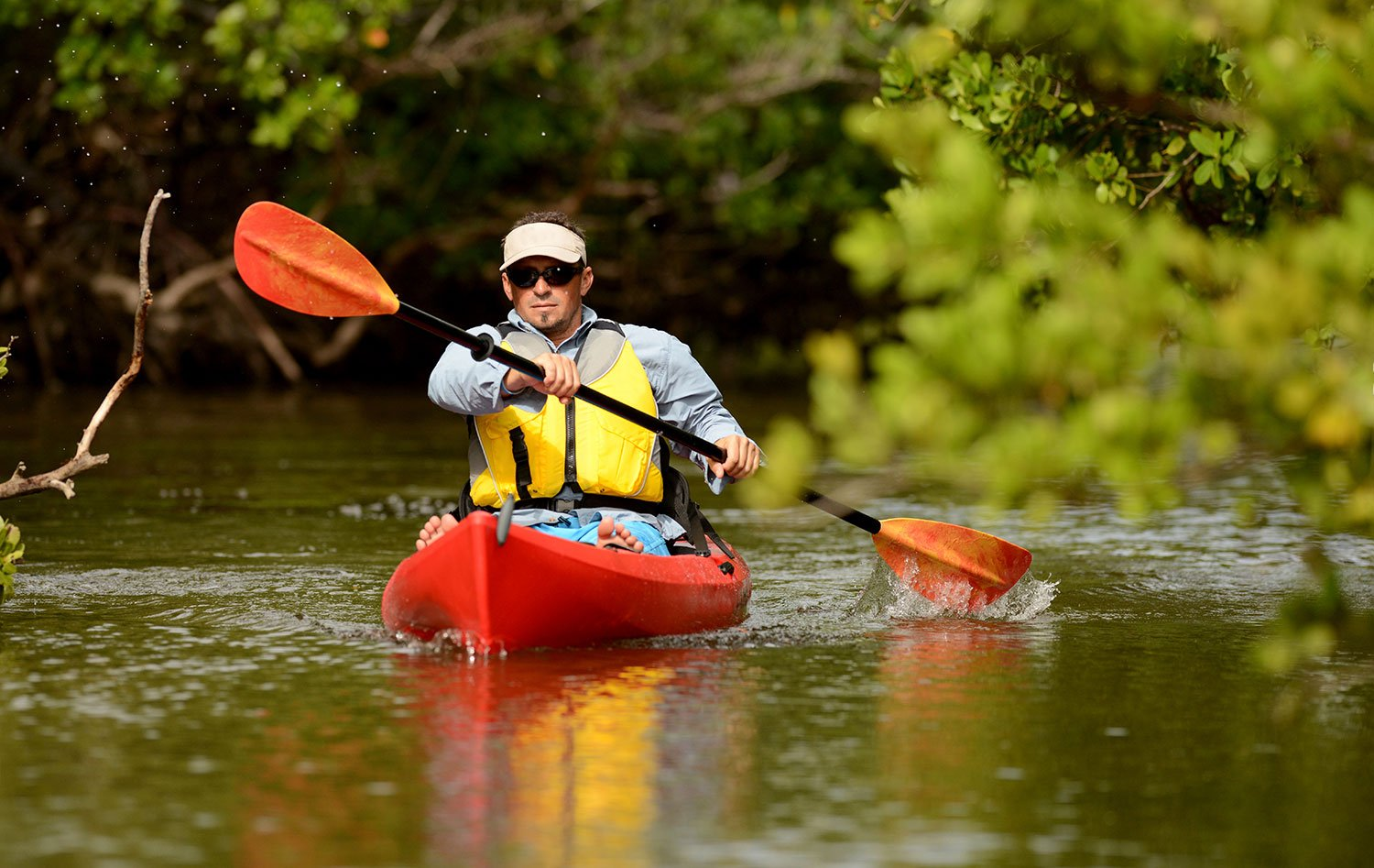 guy kayaking while attending mens outpatient rehab